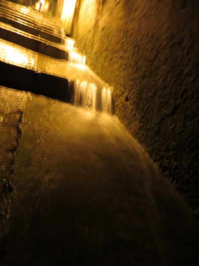 Heavy rain making a waterfall down the steps in Dubrovnik